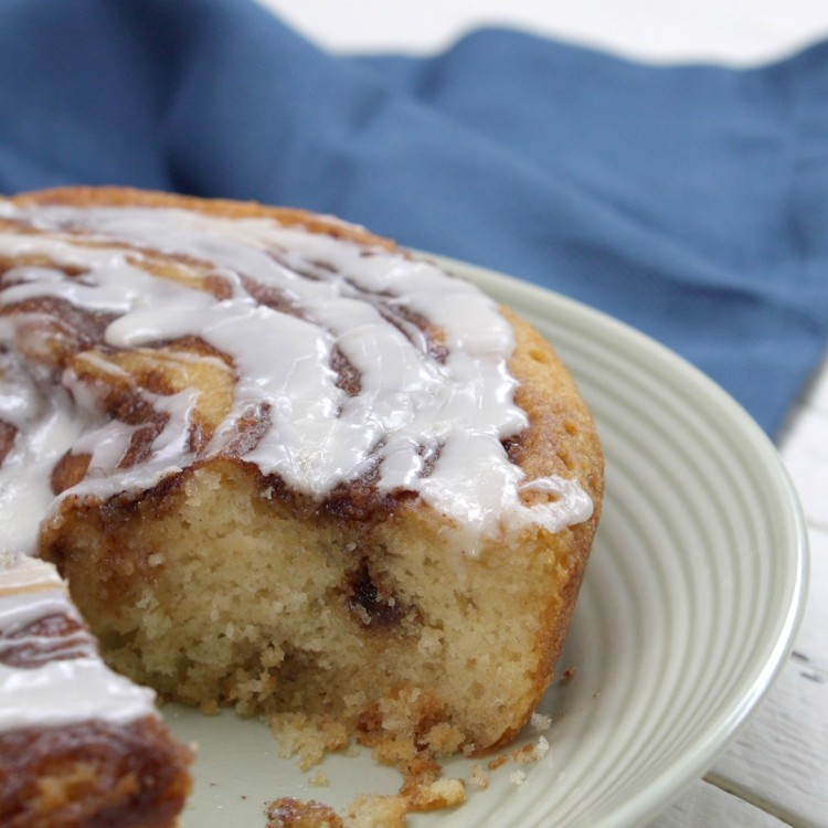 Cinnamon roll cake with piece sliced out