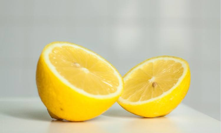 lemon halves on white background