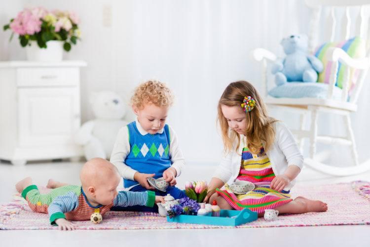 Children having a play tea party.