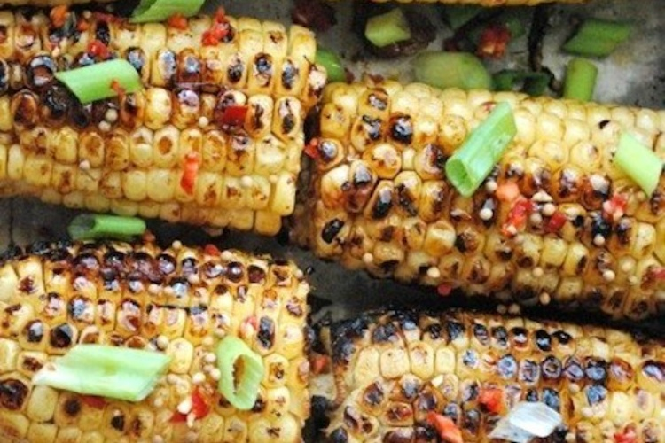 Spicy hoisin sauce and sesame seed corn on the cob