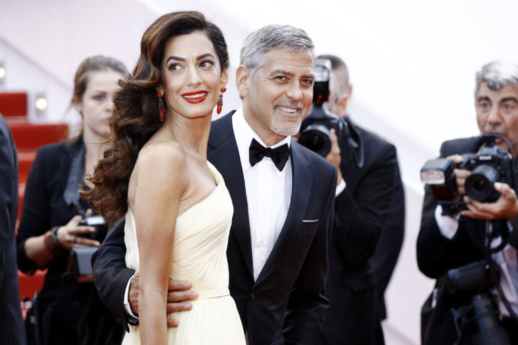 Image of George and Amal Clooney dressed up.