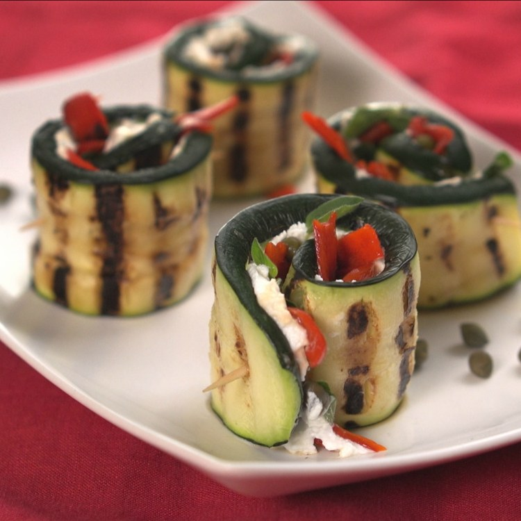 Grilled zucchini rolls with goat cheese, capers and peppers
