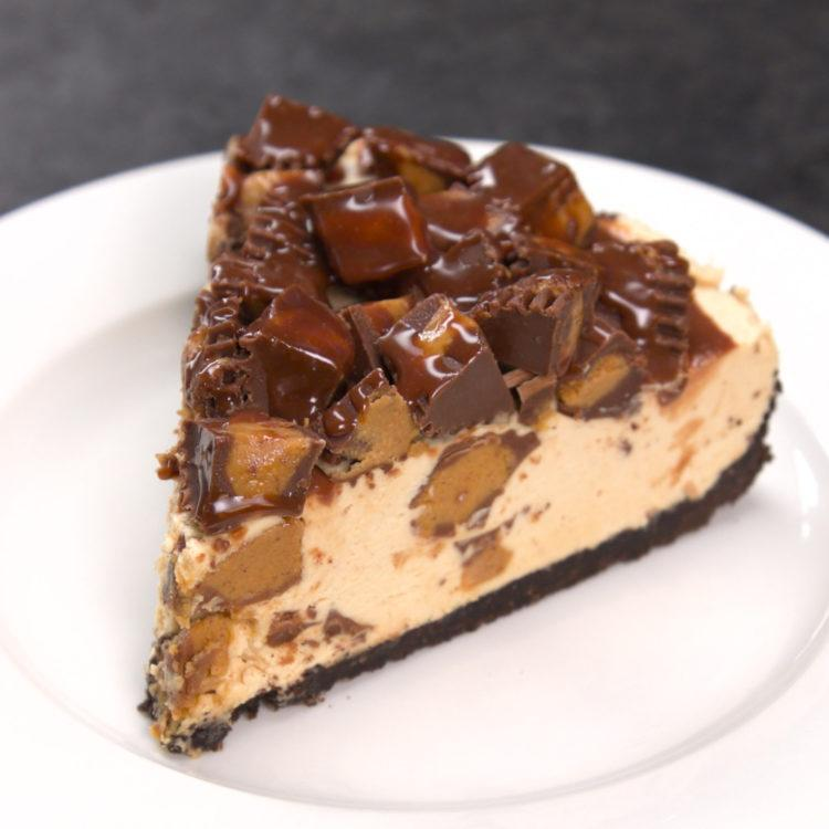 No Bake Reeses Peanut Butter Cup Cheesecake slice on plate