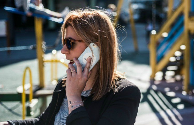 Image of woman on phone.