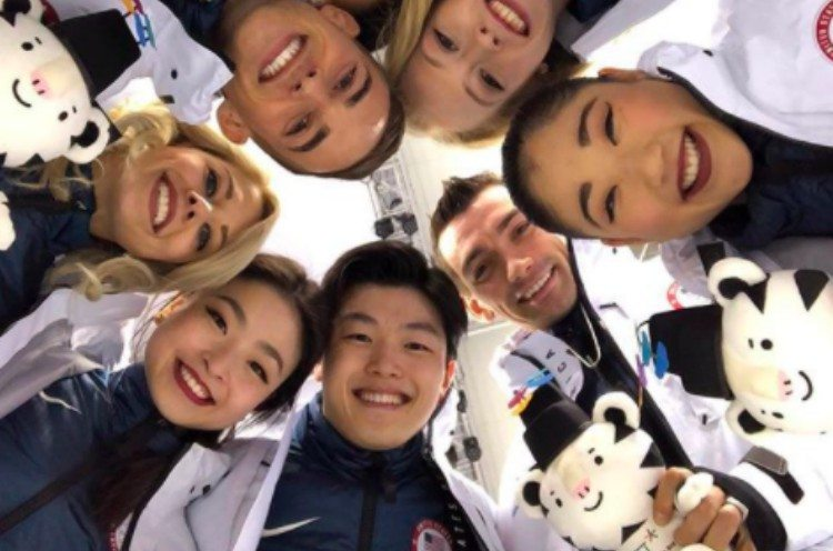 Olympians with mascot dolls