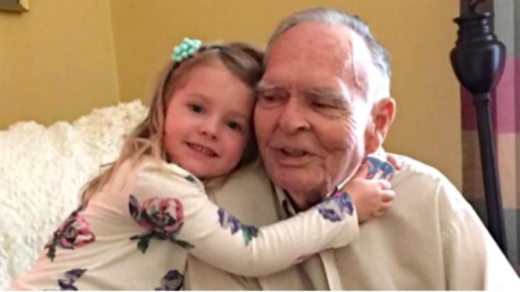 Norah hugs Mr. Dan at his home
