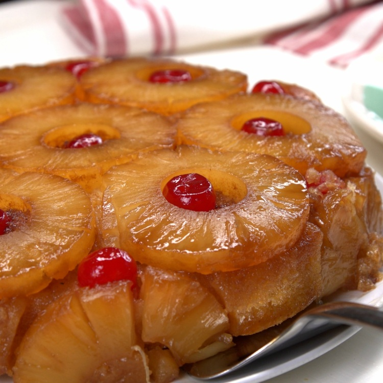 Serving a slice of pineapple upside-down cake