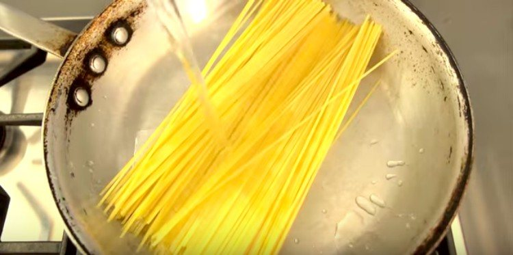 uncooked noodles in saute pan
