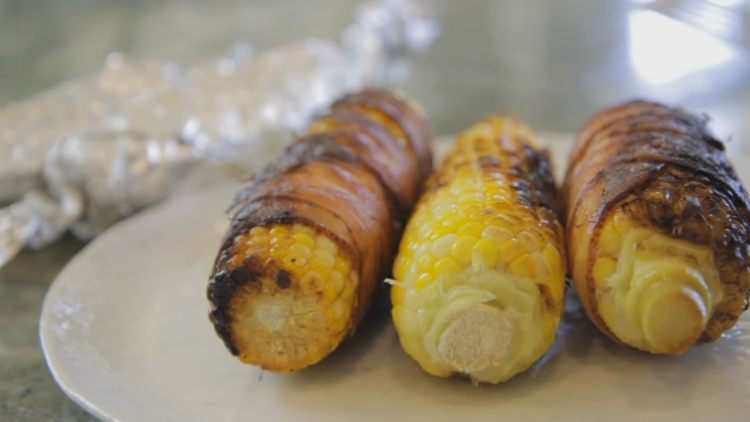 3 corn cobs wrapped in bacon slices