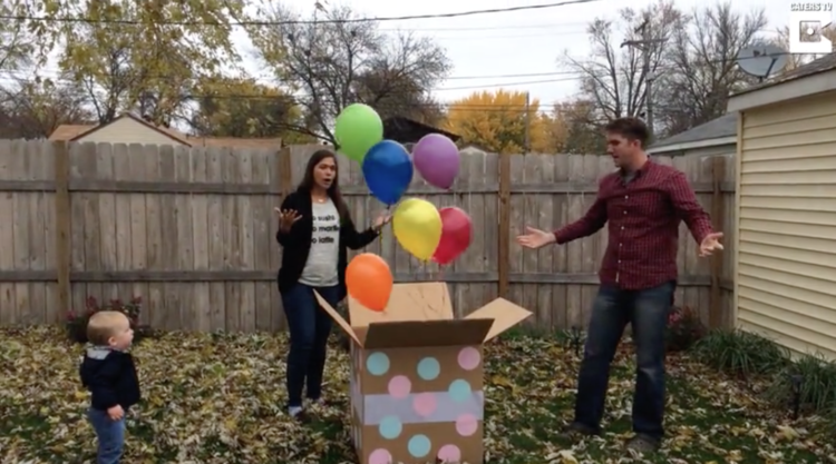 Image of couple opening box of balloons