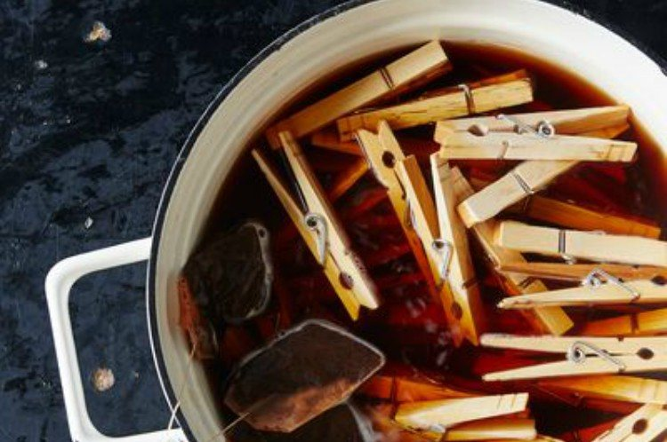 clothespins in pot with black teabags