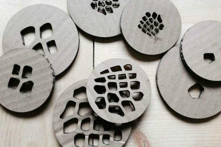 Cardboard prototypes of acrylic mason jar lid designs