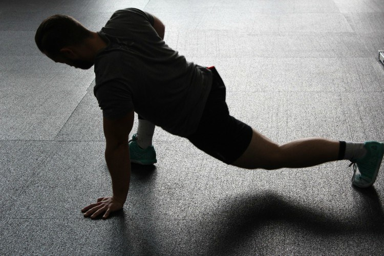 Image of man stretching.