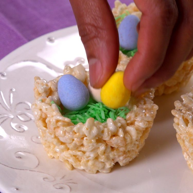 Rice Krispie Nests placing the chocolate eggs