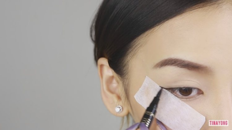 Use a piece of tape to guide the line of winged liner