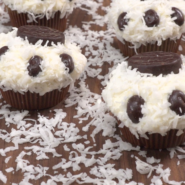 Side view of cupcakes decorated as polar bear paws
