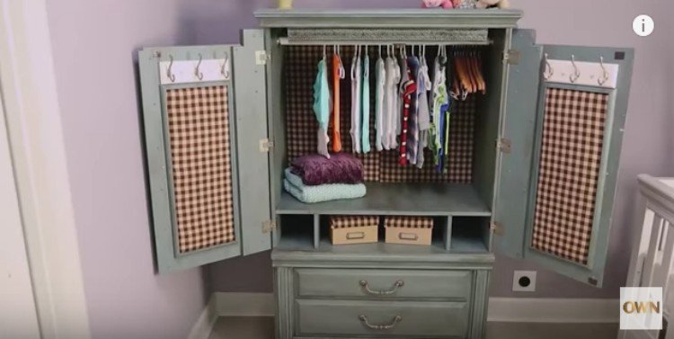 open view of blue baby armoire