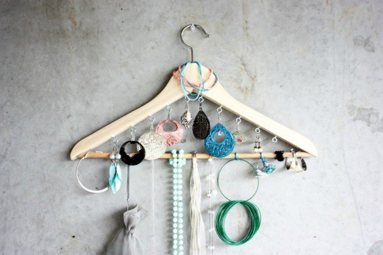 Hanger with jewelry on it.