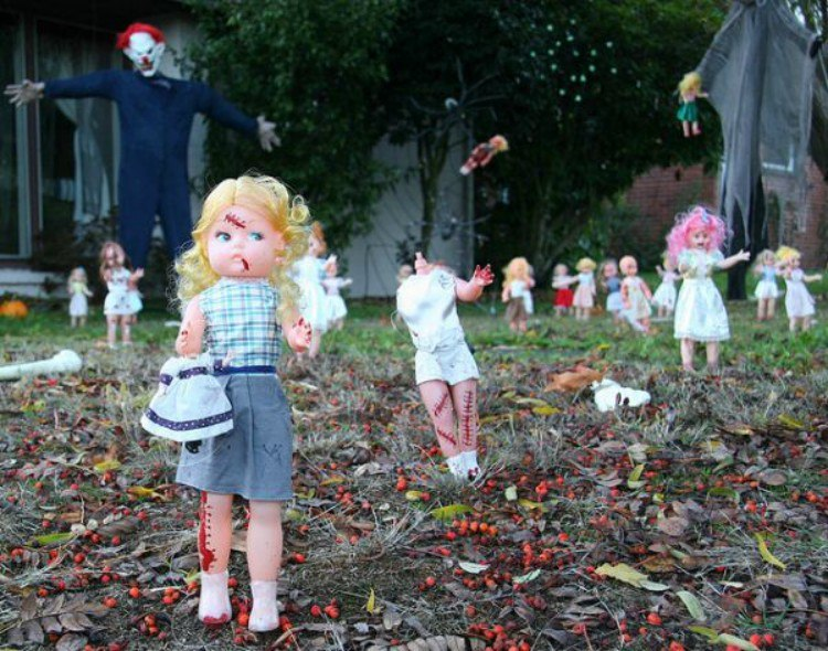 Creepy dolls in lawn.