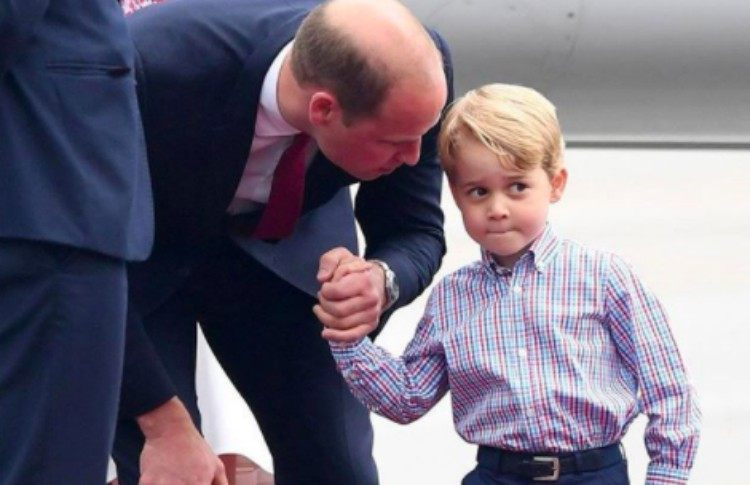Prince William talks to Prince George