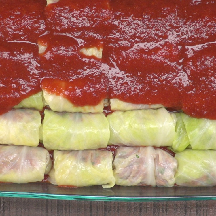 Pour remaining sauce, evenly, over the top of the cabbage rolls