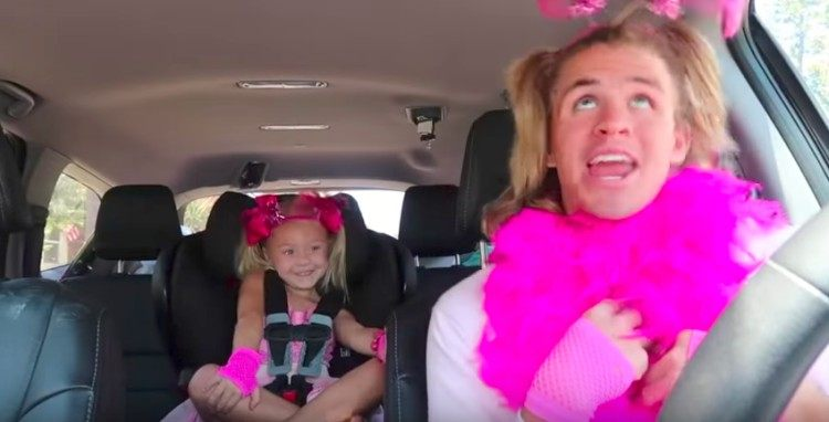 Cole and Everleigh in pink outfits in car