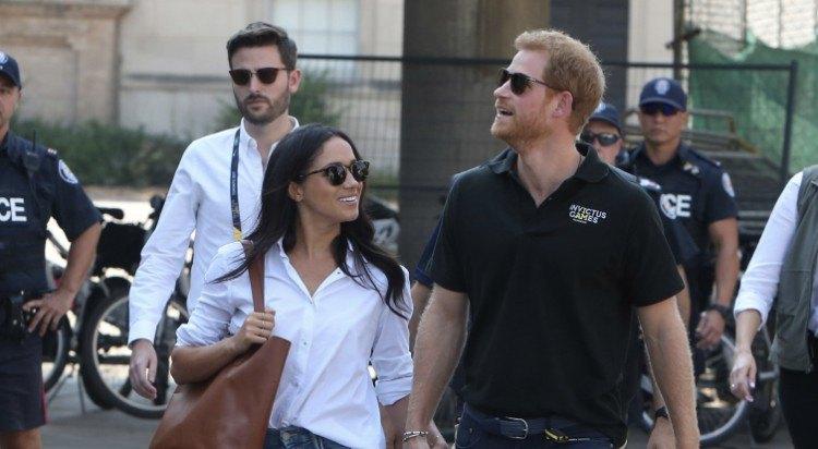 Meghan Markle and Prince Harry walking.
