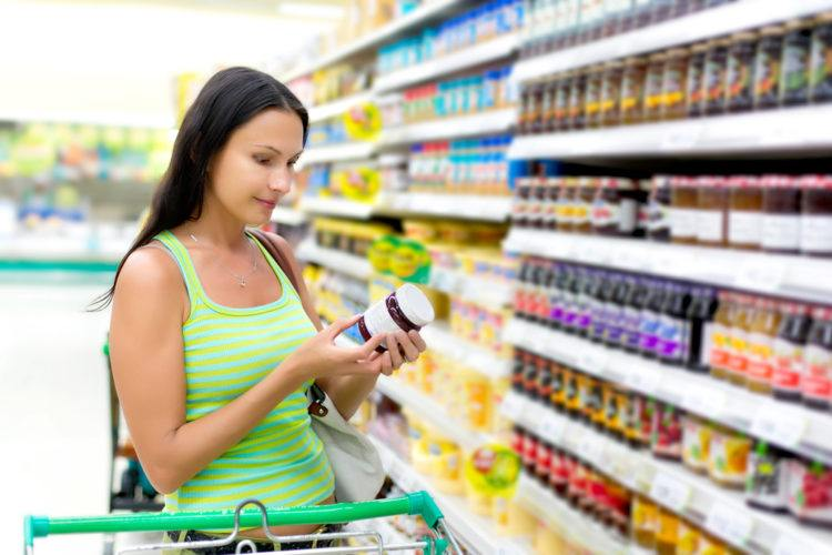 Woman checking expiration date