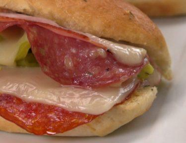 Baked sandwich with Italian meats and garlic herb butter