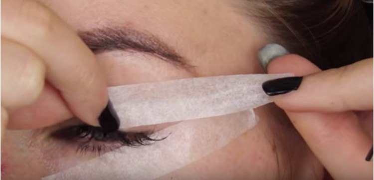 Taped eye for eyeliner.