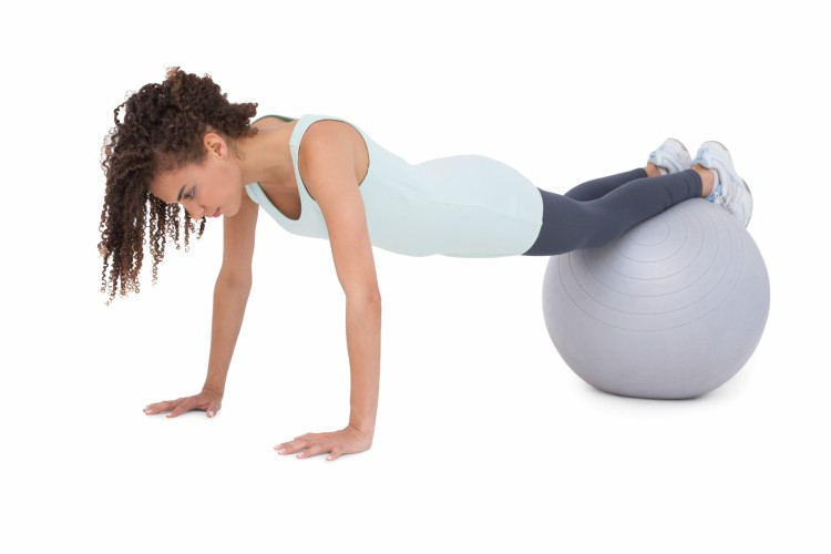 Image of woman working out on exercise ball.