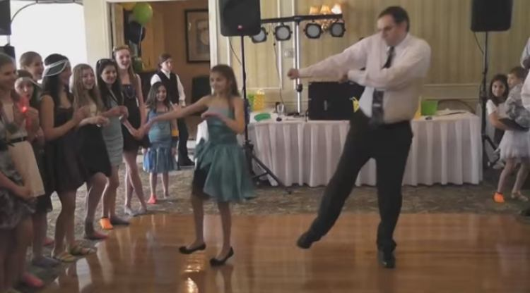 Jessica and her dad do the Soulja Boy dance.