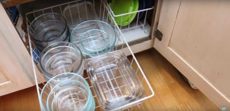 Removable wire drawers to organize containers.