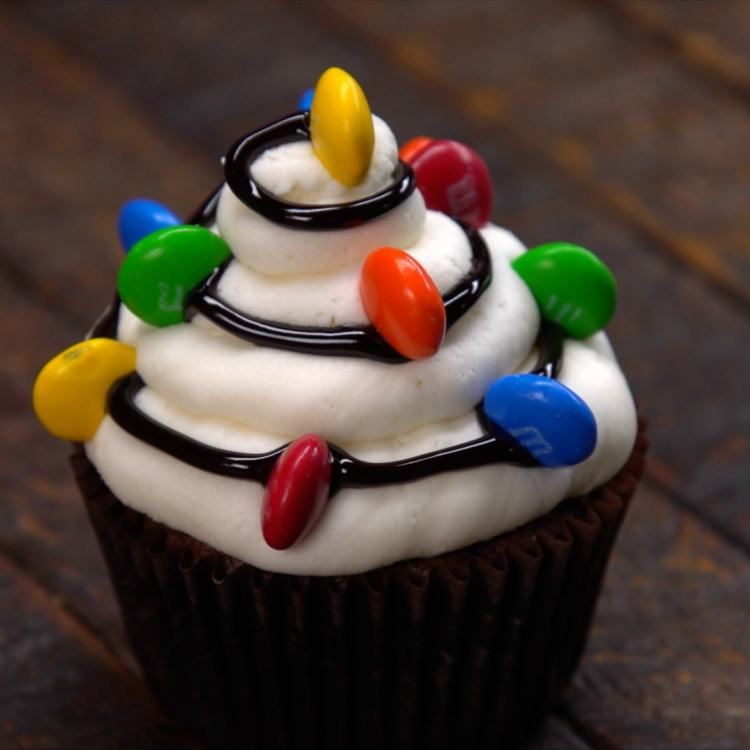 Chocolate cupcake decorated to look like Christmas lights