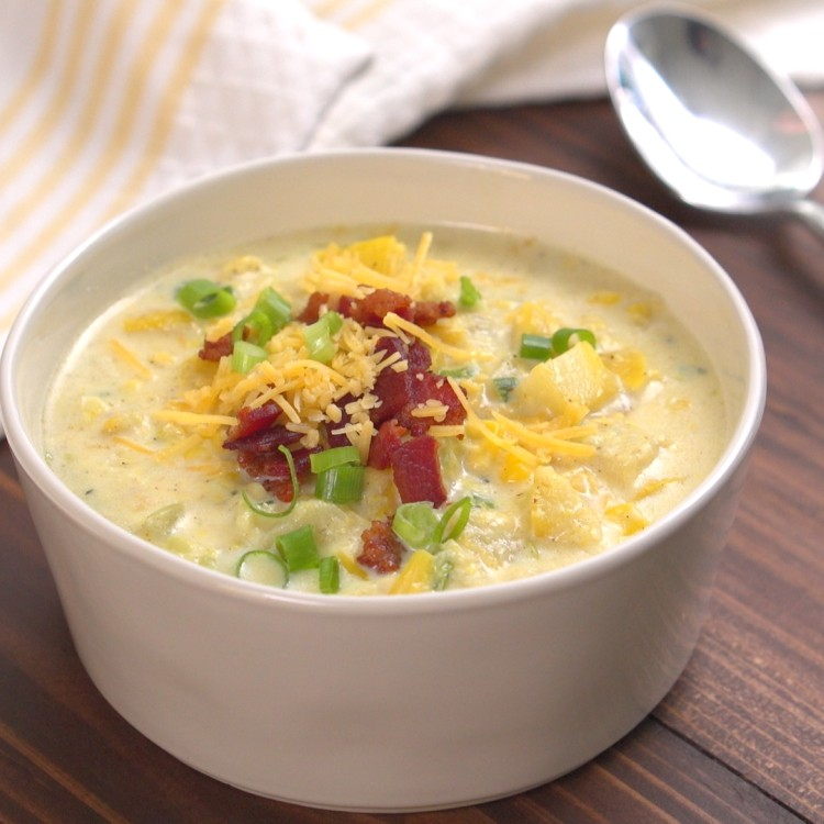 Bowl of summer squash corn chowder topped with bacon