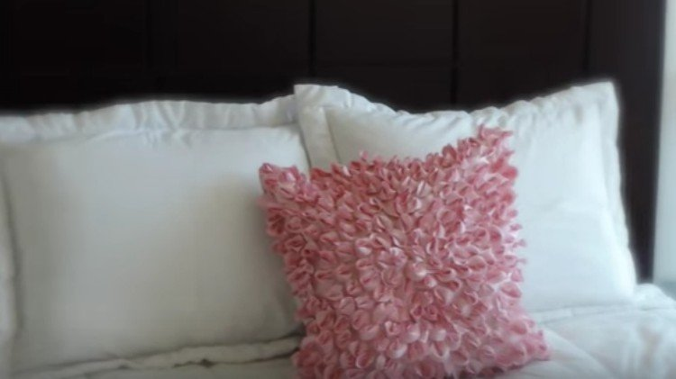 pink floral pillowcase on bed