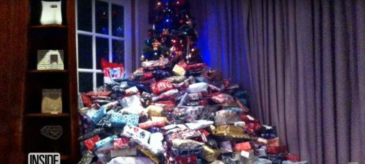 Image of Christmas tree with lots of gifts.
