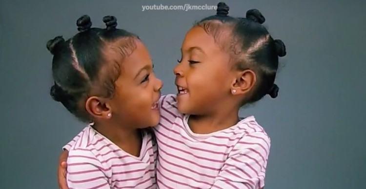 Twins Ava and Alexis hug