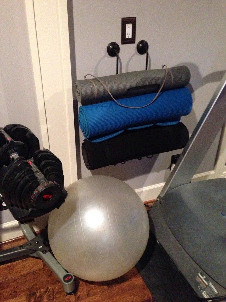 Hanging yoga mats on towel bars.