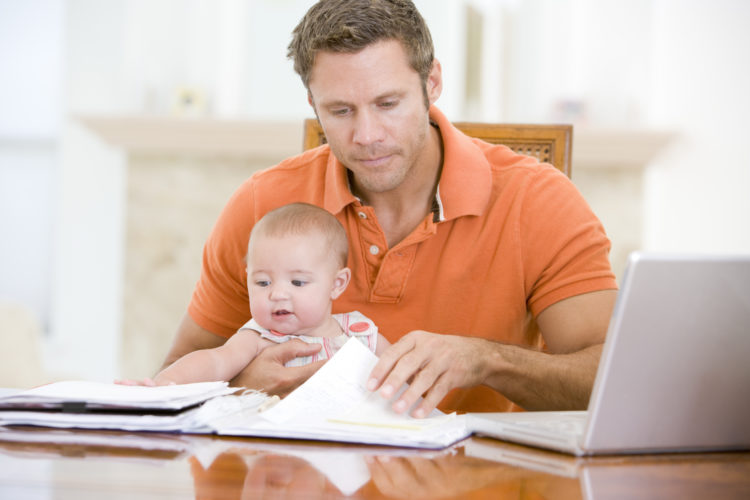 Image of dad at work with baby
