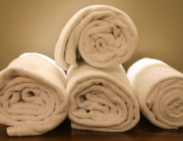Image of rolled up white towels.