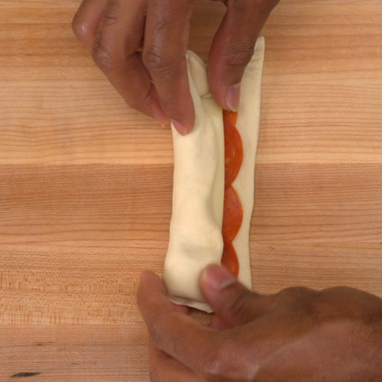 Stuffed Pizza Sticks rolling