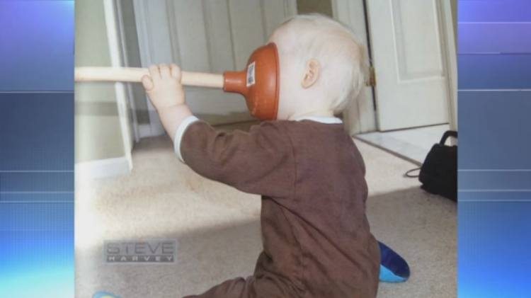 Kid with toilet plunger stuck to face