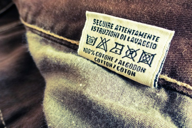 Image of jeans with tag and washing instructions.