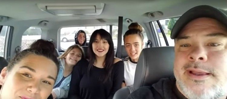 Image of family in car.
