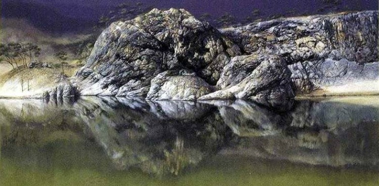Rocks reflected in water look like a woman and child