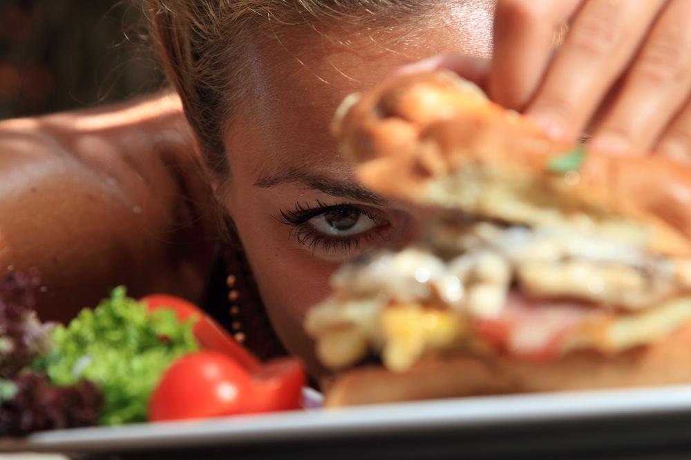 Eating a yummy cheeseburger
