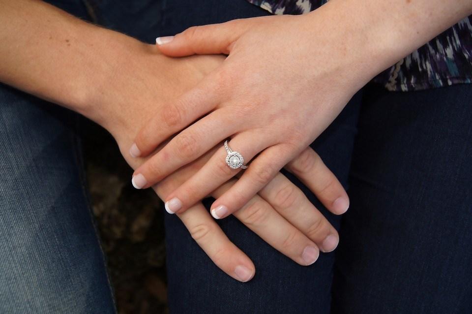 Woman wearing engagement ring.