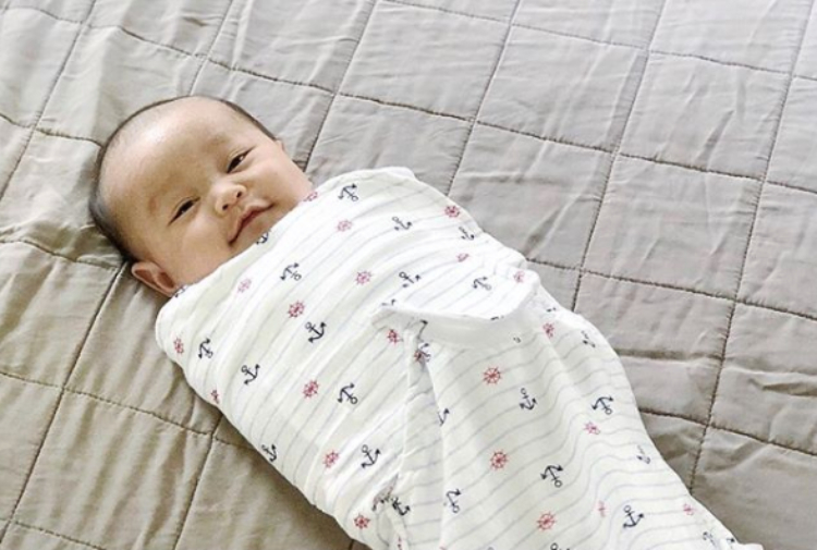 Image of baby in swaddle.