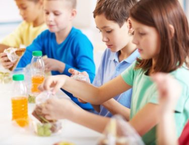 Image of children eating lunch at school.